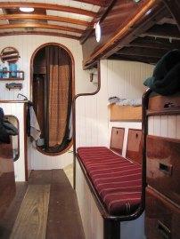 Interior main cabin facing forward, head (bathroom) is through the curtain.