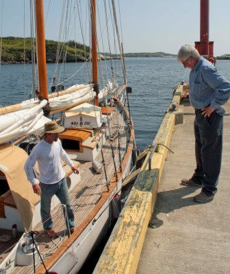 Joe Billard inspecting our lines and helping us tie up in Grand Bruit.