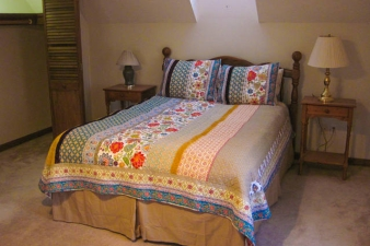 Queen size bed in upstairs room #1.