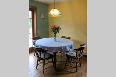 Interior dining area - table can be expanded with 2 leaves and extra chairs.