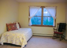 Single bed and rocking chair in upstairs bedroom #2